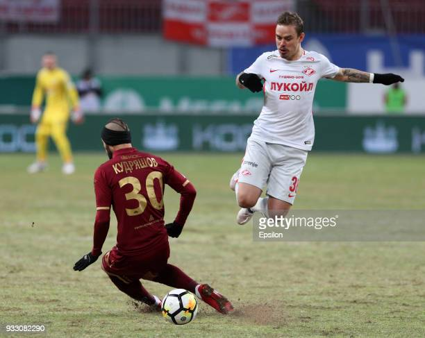 Fyodor Kudryashov of FC Rubin Kazan vies for the ball with Andrey Yeshchenko FC Spartak Moscow during the Russian Premier League match between FC...