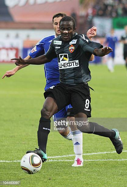 Fyodor Kudryashov of FC Tom, Tomsk battles for the ball with Seydou Doumbia of PFC CSKA, Moscow during the Russian Football League Championship match...