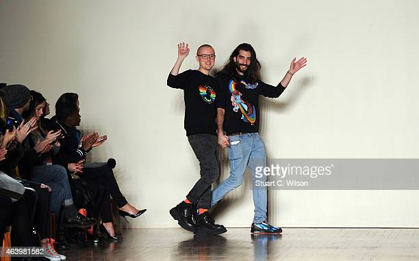 Fyodor Podgorny and Golan Frydman appear on the runway after thier show the Fyodor Golan show during London Fashion Week Fall/Winter 2015/16 at Royal...