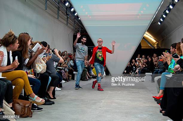Fyodor Podgorny and Golan Frydman walk the runway at the Fyodor Golan show during London Fashion Week Spring Summer 2015 on September 12 2014 in...