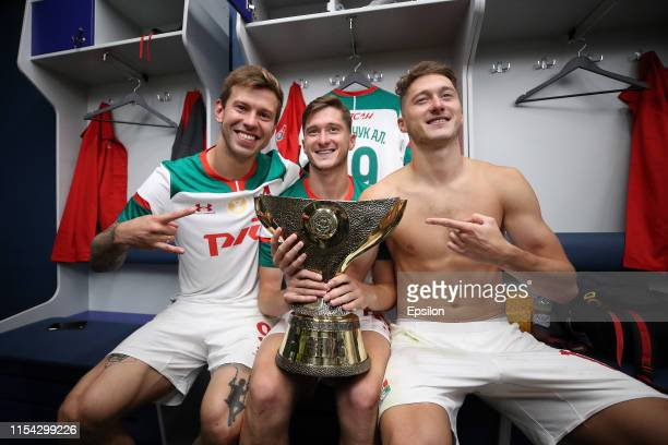 Fyodor Smolov, Aleksei Miranchuk and Anton Miranchuk of FC Lokomotiv Moscow pose with the trophy after the Super Cup of Russia 2019 match between FC...