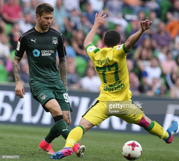 Fyodor Smolov of FC Krasnodar is challenged by Ayaz Guliyev of FC Anzhi Makhachkala during the Russian Premier League match between FC Krasnodar v FC...