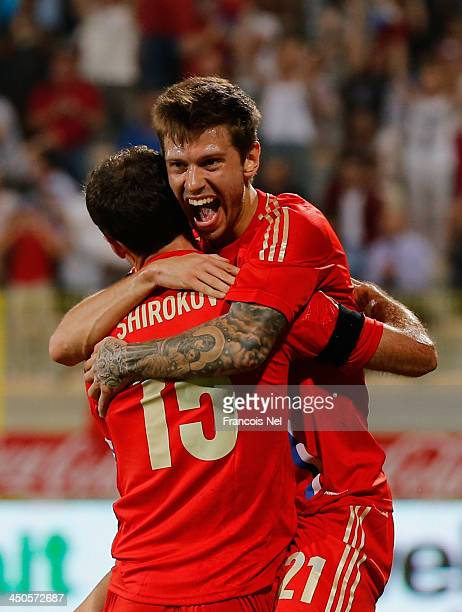 Fyodor Smolov of Russia celebrates his goal with team mate Roman Shirokov during the International friendly match between South Korea and Russia at...