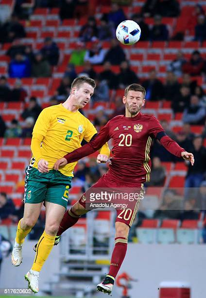 Fyodor Smolov of Russia National football team in action against Linas Klimavicius of Lithuania National football team during the friendly football...