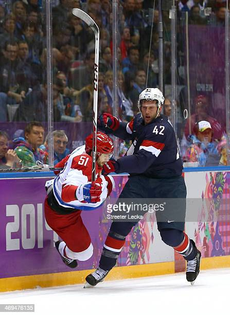 Fyodor Tyutin of Russia collides with David Backes of the United States during the Men's Ice Hockey Preliminary Round Group A game on day eight of...