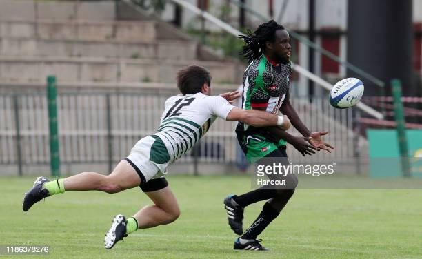 Gaan Oneill of Zimbabwe challenges Samaila Nihu Ibrahim of Nigeria during the 2019 Rugby Africa Mens 7s match between Nigeria and Zimbabwe at the...