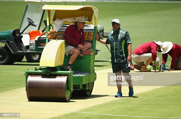 Gabba curator Kevin Mitchell Jr and Darren Lehmann coach of Australia speak during an Australian Nets Session at The Gabba on December 16 2014 in...