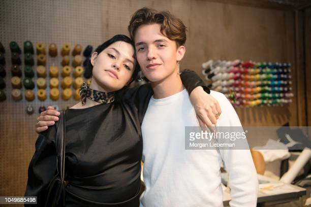 Gabbriette Bechtel and Noah Urrea attend the Gabbriette Junk Food photo exhibition and capsule collection launch at Tees Jeans on October 4 2018 in...