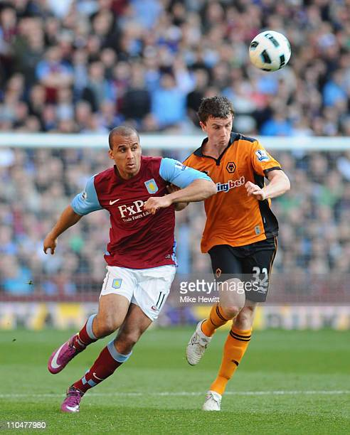 Gabby Agbonlahor of Aston Villa is challenged by Kevin Foley of Wolves during the Barclays Premier League match between Aston Villa and Wolverhampton...