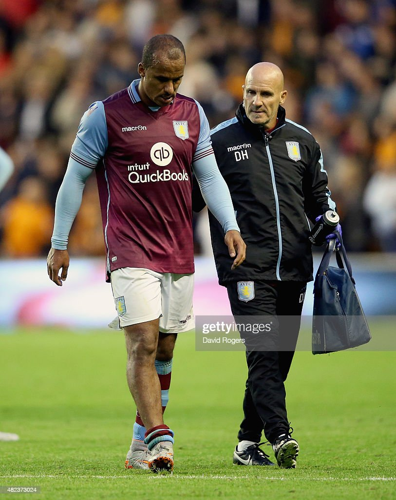 Gabby Agbonlahor of Aston Villa is helped off the field after an injury during the pre season friendly between Wolverhampton Wanderers and Aston Villa at Molineux on July 28, 2015 in Wolverhampton, England.