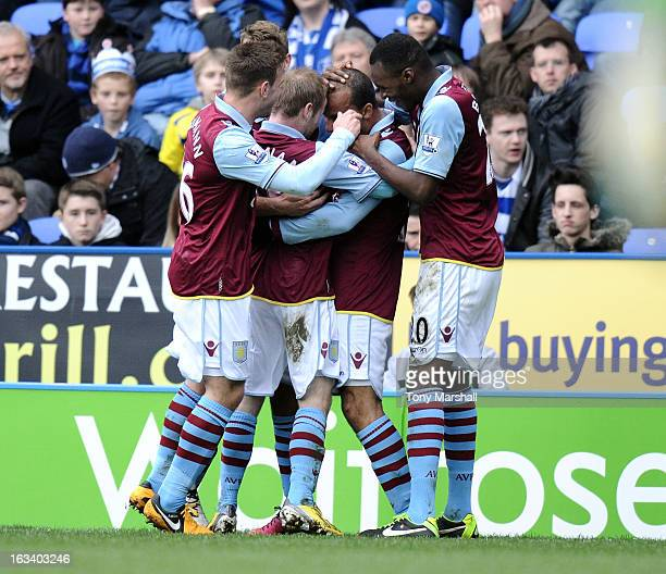 Gabby Agbonlahor of Aston Villa is mobbed by his team mates after scoring their second goal during the Premier League match between Reading and Aston...