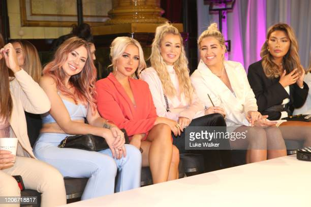 Gabby Allen and guests attend the Oh Polly Fashion Show By Planet Fashion at London Fashion Week at The Royal Horseguards on February 16 2020 in...