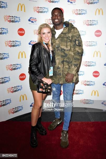 Gabby Allen and Marcel Somerville poses backstage at Fusion Festival on September 3 2017 in Liverpool England