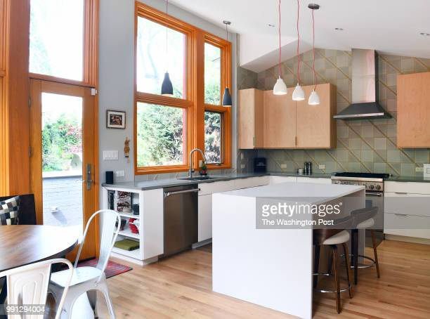 Gabby and Todd Gillenwater renovated the home they bought two years ago to expand the kitchen with an large island with seating photographed May 06...