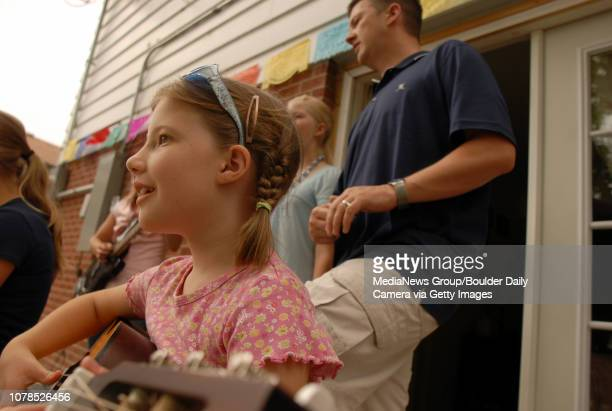 Gabby Diamond left plays the guitar with her family for friends at their Broomfield Heights home on Friday June 292007 Photo/David R Jennings