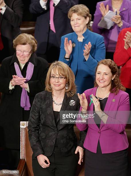 Gabby Giffords and Rep Elizabeth Esty listen to US President Barack Obama deliver the State of the Union speech before members of Congress in the...