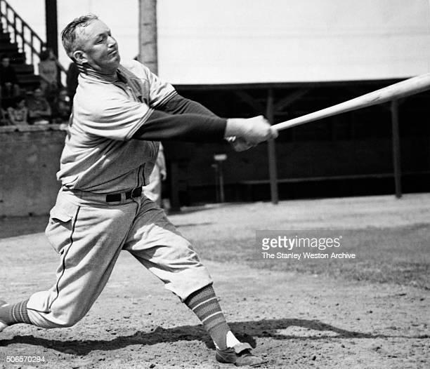 Gabby Hartnett catcher of the Chicago Cubs hits a home run circa 1939