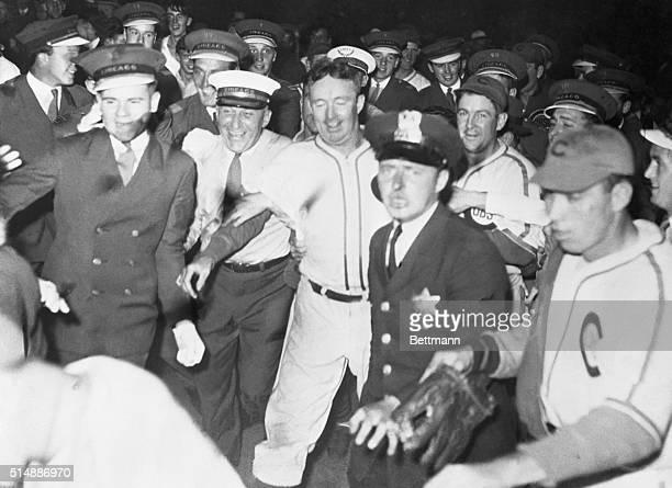 Gabby Hartnett of the Cubs being mobbed after hitting pennant winning homerun in 1938