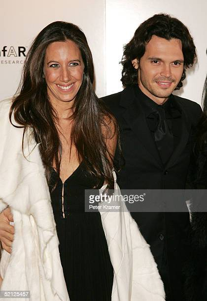 Gabby Karan and husband attend the amfar and ACRIA gala benefit honoring photographer Herb Ritts on February 2 2005 in New York City