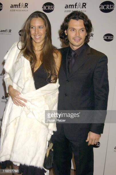 Gabby Karan and husband during amfAR and ACRIA Honor Herb Ritts with a Sale of Contemporary Artwork Arrivals at Sothebys in New York New York United...