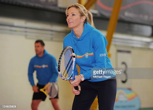 Gabby Logan and Kenny Logan play tennis during the LTA Mini Tennis launch at Ravenscraig Sports Centre on September 14 2011 in Motherwell Scotland