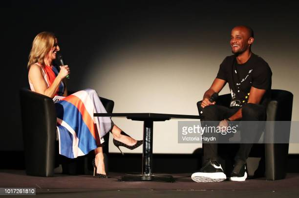 Gabby Logan and Manchester City's Vincent Kompany introduce the premier at The Printworks on August 15 2018 in Manchester England