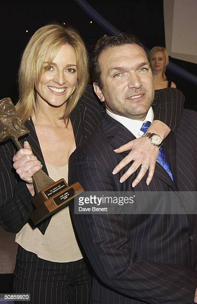 Gabby Logan and Neil Ruddock attend the 2004 Tric Awards at The Grovesnor House Hotel on March 10 2004 in London