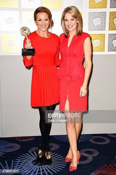 Gabby Logan poses in the winners room at the TRIC awards 2014 at the Grosvenor House Hotel on March 11 2014 in London England
