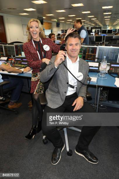 Gabby Logan representing Sparks with Robert Bathurst representing Jos Cervivcal TrustÊmake a trade at GFI Charity Day 2017 on September 11 2017 in...
