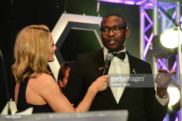 Gabby Logan speaks with Shola Ameobi during the Newcastle United Foundation's United as One annual dinner at St. James Park on November 05, 2019 in...