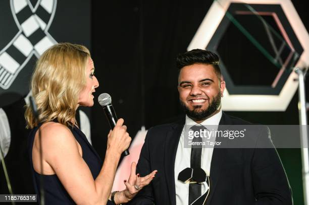 Gabby Logan speaks with Young Leader Award Winner Imran Ali during the Newcastle United Foundation's United as One annual dinner at St. James Park on...
