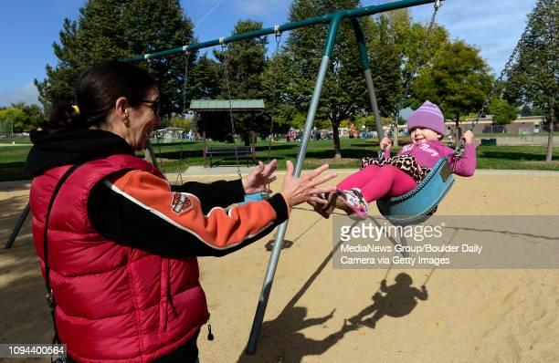 Gabby Nardell gets a push on the swing from friend Tammy TrujilloValdez at Kanemoto Park Saturday morning Oct 12 2013