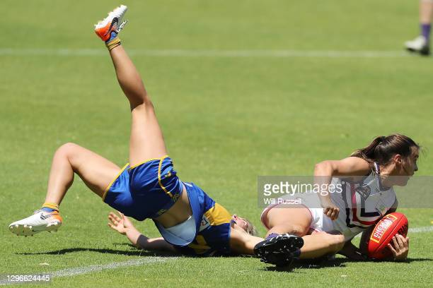 Gabby O'Sullivan of the Dockers is tackled by Maddy Collier of the Eagles during an AFLW pre-season match between the West Coast Eagles and the...