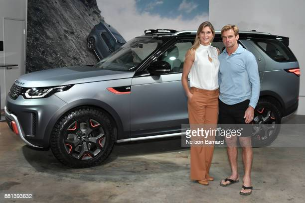Gabby Reece and Laird Hamilton with the Land Rover Discovery SVX at an exclusive customer preview which introduced three new vehicles from Jaguar...