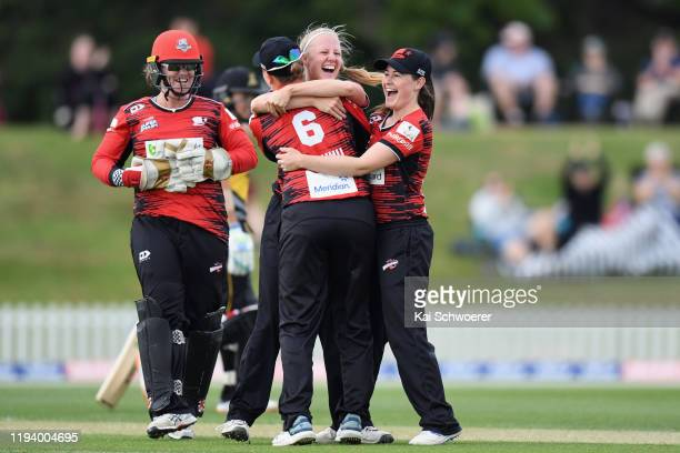 Gabby Sullivan of the Magicians is congratulated by team mates after achieving a hattrick by dismissing Thamsyn Newton of the Blaze during the...