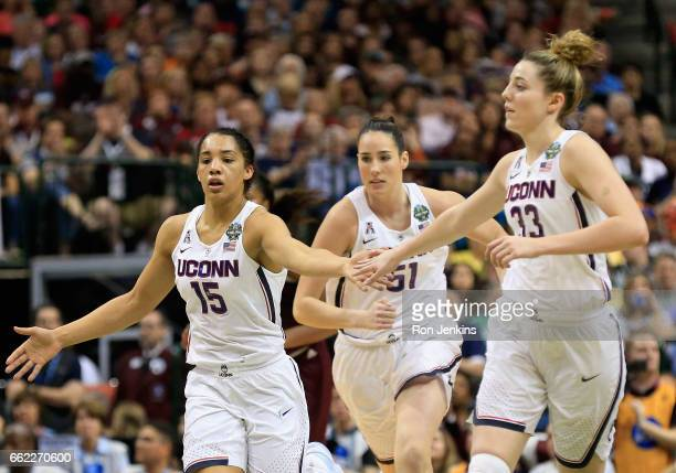 Gabby Williams Natalie Butler Katie Lou Samuelson of the Connecticut Huskies celebrate in the first half against the Mississippi State Lady Bulldogs...