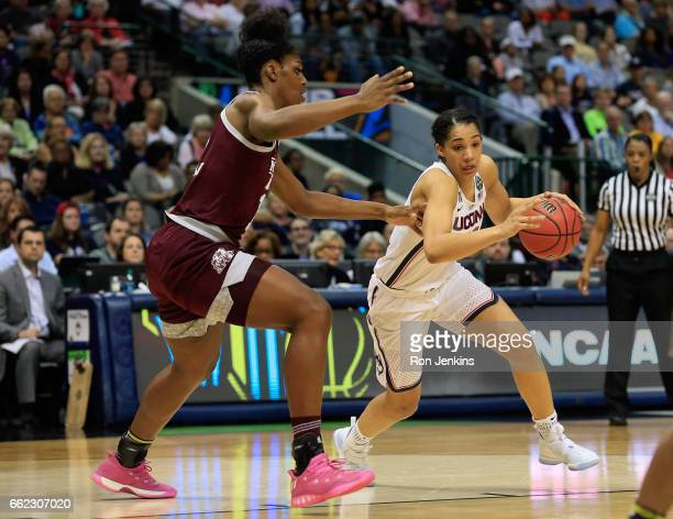 Gabby Williams of the Connecticut Huskies drives against Teaira McCowan of the Mississippi State Lady Bulldogs in the third quarter during the...