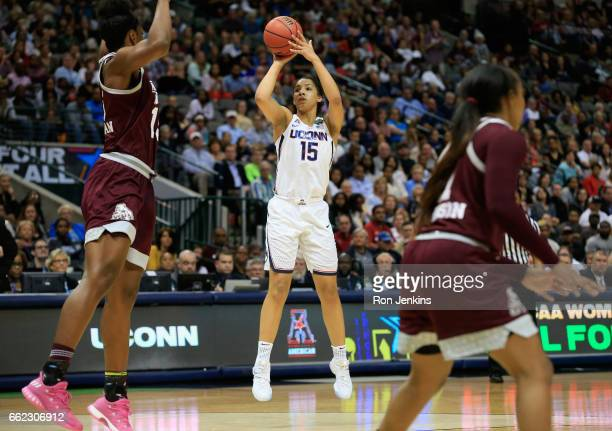 Gabby Williams of the Connecticut Huskies shoots against Teaira McCowan of the Mississippi State Lady Bulldogs in the third quarter during the...