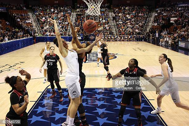 Gabby Williams UConn is fouled by Marley Hill Cincinniti during the UConn Vs Cincinnati Quarterfinal Basketball game at the American Women's College...