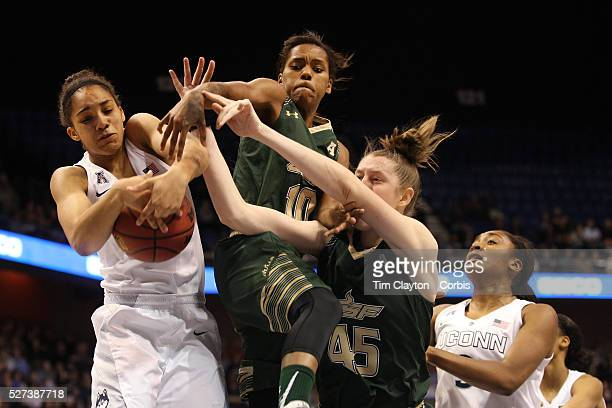 Gabby Williams UConn rebounds while challenged by Courtney Williams and Katelyn Weber USF during the UConn Huskies Vs USF Bulls Basketball Final game...