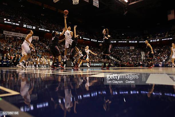 Gabby Williams UConn shoots past Shelbi Chandler and Chelsea Jamison Cincinnati during the UConn Vs Cincinnati Quarterfinal Basketball game at the...