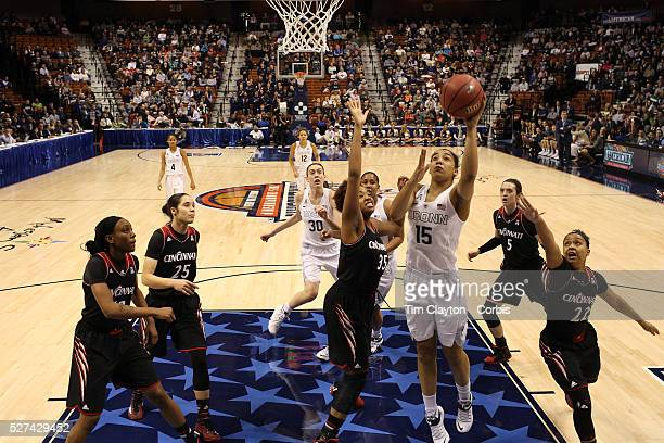 Gabby Williams UConn shoots while challenged by Marley Hill Cincinniti during the UConn Vs Cincinnati Quarterfinal Basketball game at the American...
