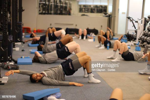 Gabby Williams with team mates during warm down and stretching under the supervision of strength coach Amanda Kimball during the The UConn Huskies...