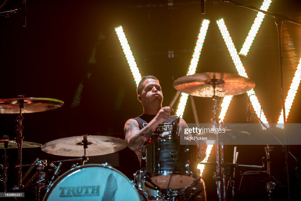 Gabe Barham of Sleeping With Sirens performs on stage at Brixton Academy on October 10, 2013 in London, England.