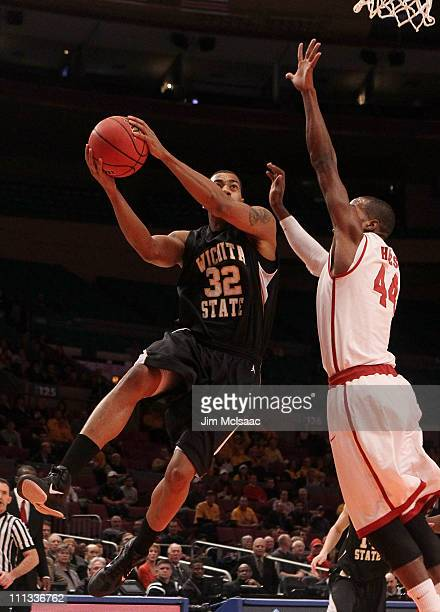 Gabe Blair of the Wichita State Shockers goes to the hoop against Chris Hines of the Alabama Crimson Tide during the 2011 NIT Championship game on...