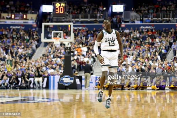 Gabe Brown of the Michigan State Spartans celebrates a three point basket against the LSU Tigers during the second half in the East Regional game of...