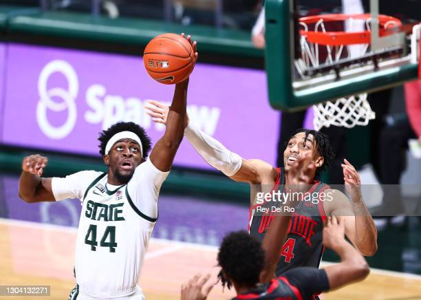 Gabe Brown of the Michigan State Spartans grabs a rebound against Justice Sueing of the Ohio State Buckeyes in the second half at Breslin Center on...