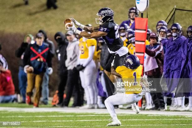 Gabe Brown of the University of Mount Union leaps to intercept the ball from Bryce Wilkerson of the University of Mary HardinBaylor during the...