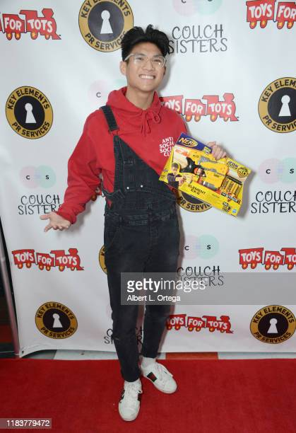 Gabe DeGuzman attends The Couch Sisters 1st Annual Toys For Tots Toy Drive held onNovember 20 2019 in Glendale California