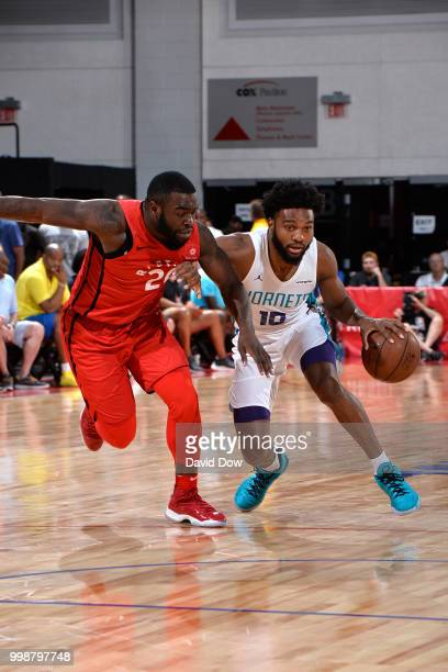 Gabe Devoe of the Charlotte Hornets handles the ball Giddy Potts of the Toronto Raptors during the 2018 Las Vegas Summer League on July 14 2018 at...